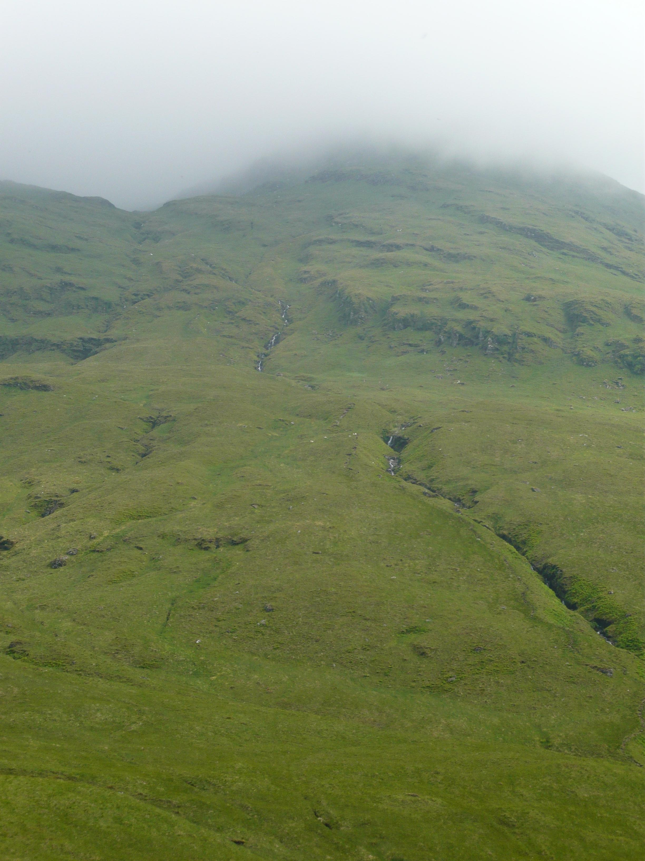 Walking up into the mist on Ben Lui